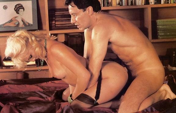 legs over shoulders sex position